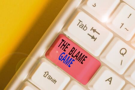 Handwriting text The Blame Game. Conceptual photo A situation when showing attempt to blame one another White pc keyboard with empty note paper above white background key copy space Stock fotó