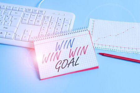 Text sign showing Win Win Win Goal. Business photo showcasing Approach that aims to satisfy all parties involved Paper blue desk computer keyboard office study notebook chart numbers memo Stock Photo