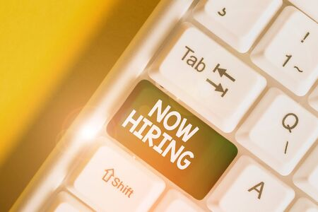 Text sign showing Now Hiring. Business photo text Workforce Wanted Employees Recruitment Today Job Opportunity White pc keyboard with empty note paper above white background key copy space