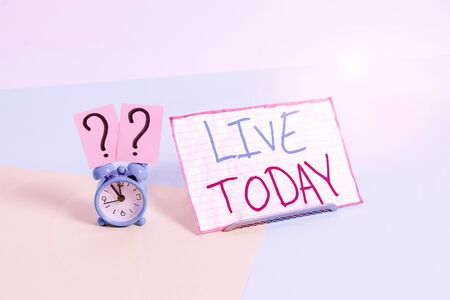 Handwriting text Live Today. Conceptual photo spend your life doing what you want Live in the present moment Mini size alarm clock beside a Paper sheet placed tilted on pastel backdrop
