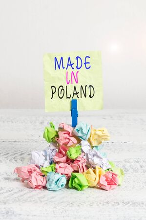 Writing note showing Made In Poland. Business concept for A product or something that is analysisufactured in Poland Reminder pile colored crumpled paper clothespin wooden space Archivio Fotografico