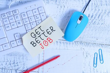 Text sign showing Get Better Job. Business photo showcasing Looking for a high paying occupation Stress free work Writing equipments and computer stuffs placed above classic wooden table Stock fotó