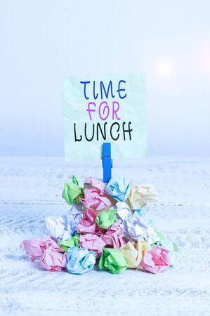 Writing note showing Time For Lunch. Business concept for Moment to have a meal Break from work Relax eat drink rest Reminder pile colored crumpled paper clothespin wooden space