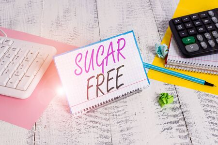 Text sign showing Sugar Free. Business photo text containing an artificial sweetening substance instead of sugar Notepaper stand on buffer wire in between computer keyboard and math sheets Zdjęcie Seryjne