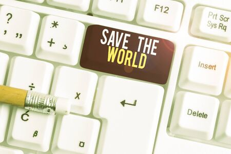 Text sign showing Save The World. Business photo text Protect the environment and the living species Ecosystem White pc keyboard with empty note paper above white background key copy space Zdjęcie Seryjne - 134312932