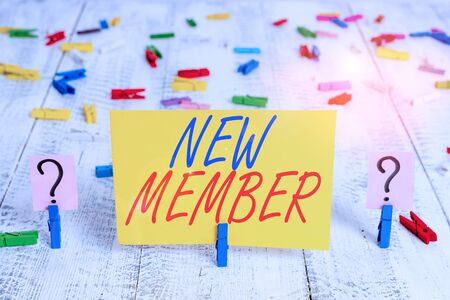 Writing note showing New Member. Business concept for recruiting employee to company or team Birth of fresh child Crumbling sheet with paper clips placed on the wooden table