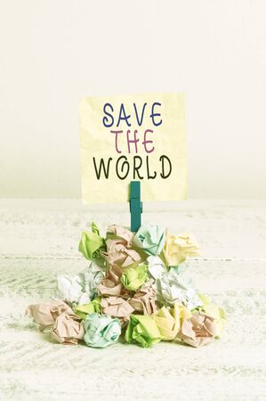 Writing note showing Save The World. Business concept for Protect the environment and the living species Ecosystem Reminder pile colored crumpled paper clothespin wooden space Zdjęcie Seryjne - 134313097