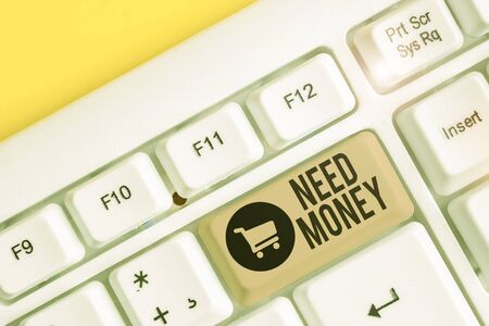 Conceptual hand writing showing Need Money. Concept meaning require a financial assistance to sustain spending or endeavor White pc keyboard with note paper above the white background