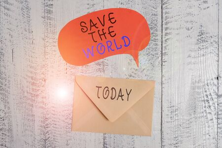 Handwriting text writing Save The World. Conceptual photo Protect the environment and the living species Ecosystem Front view closed envelop speech bubble lying wooden vintage background