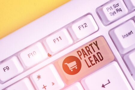 Conceptual hand writing showing Party Lead. Concept meaning acts as the official representative of their political party White pc keyboard with note paper above the white background