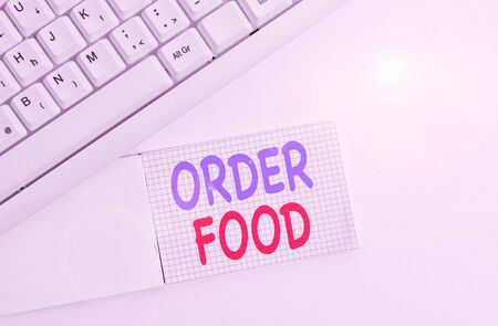 Handwriting text writing Order Food. Conceptual photo the process of requesting a preferred food in a restaurant White pc keyboard with empty note paper above white background Stockfoto