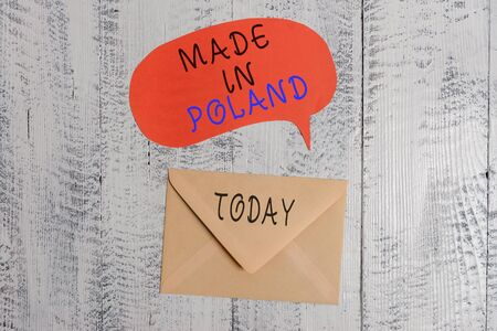 Handwriting text writing Made In Poland. Conceptual photo A product or something that is analysisufactured in Poland Front view closed envelop speech bubble lying wooden vintage background