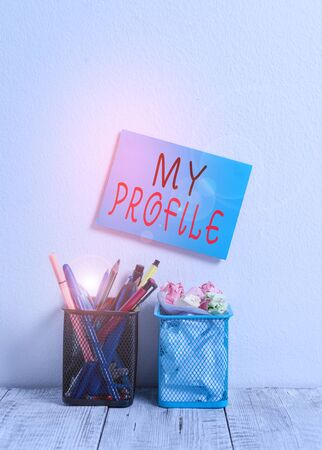 Text sign showing My Profile. Business photo text record of your demonstratingal information that defines who you are Blue Sticky Card on Wall Two Pencil Pots Pens Pencils Markers Waste Paper