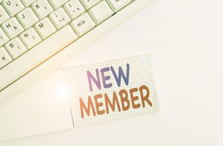 Handwriting text writing New Member. Conceptual photo recruiting employee to company or team Birth of fresh child White pc keyboard with empty note paper above white background Stock Photo