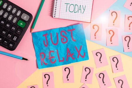 Handwriting text writing Just Relax. Conceptual photo to rest or do something that is enjoyable and stress free Mathematics stuff and writing equipment above pastel colours background 版權商用圖片
