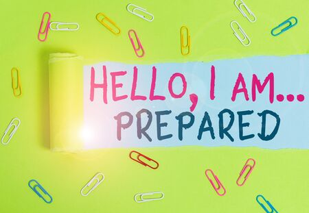 Writing note showing Hello I Am Prepared. Business concept for introduce yourself to someone as you are ready Paper clip and torn cardboard on wood classic table backdrop Фото со стока