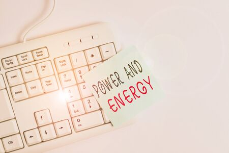 Writing note showing Power And Energy. Business concept for Electricity electric distribution industry Energetic White pc keyboard with empty note paper above white background Zdjęcie Seryjne - 134314817