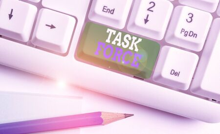 Text sign showing Task Force. Business photo text a group of showing who are brought together to do a particular job White pc keyboard with empty note paper above white background key copy space