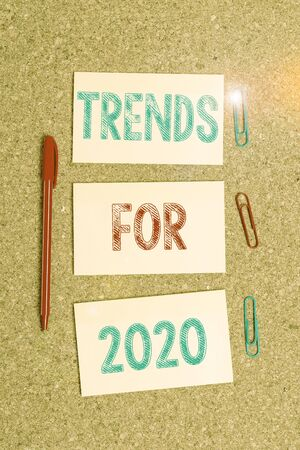 Writing note showing Trends For 2020. Business concept for list of things that got popular very quickly in this year Empty sticker reminder memo billboard corkboard desk paper Stock Photo - 134314823