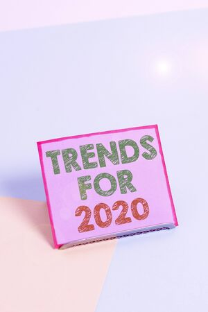 Word writing text Trends For 2020. Business photo showcasing list of things that got popular very quickly in this year Paper placed tilted above buffer wire on soft pastel multi colours backdrop Foto de archivo