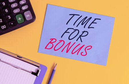 Writing note showing Time For Bonus. Business concept for a sum of money added to a demonstrating s is wages as a reward Clipboard blank sheet square page calculator pencil colored background