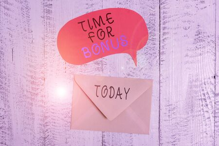 Handwriting text writing Time For Bonus. Conceptual photo a sum of money added to a demonstrating s is wages as a reward Front view closed envelop speech bubble lying wooden vintage background