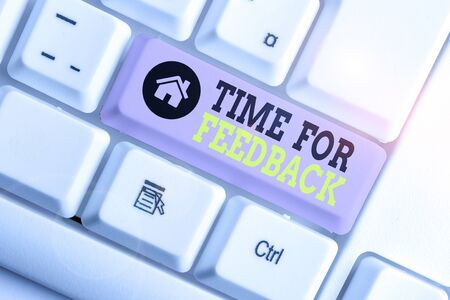 Conceptual hand writing showing Time For Feedback. Concept meaning Need to response or give critic on something Evaluation White pc keyboard with note paper above the white background