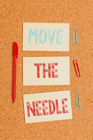 Écrit remarque montrant déplacer l'aiguille. Concept d'entreprise pour faire une différence notable dans quelque chose faire mieux