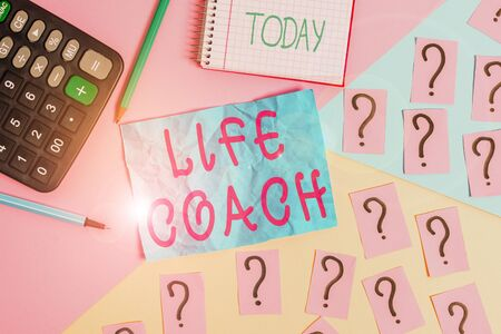 Handwriting text writing Life Coach. Conceptual photo someone who helps identify your goals and plan to achieve them Mathematics stuff and writing equipment above pastel colours background