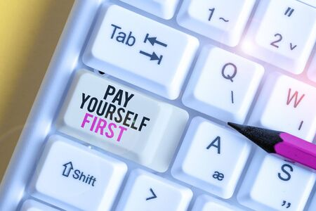 Handwriting text Pay Yourself First. Conceptual photo Saving for future Setting aside a Portion of your income White pc keyboard with empty note paper above white background key copy space