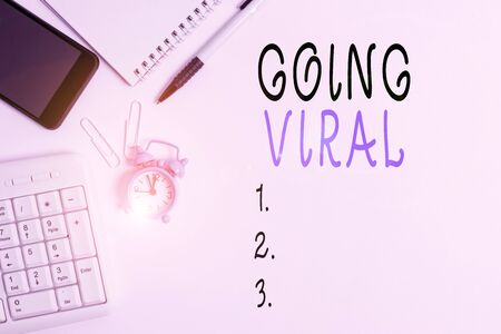 Conceptual hand writing showing Going Viral. Concept meaning something that that spreads rapidly through a population Business concept with space for advertising and text message