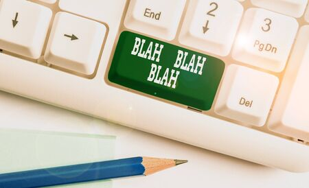 Text sign showing Blah Blah Blah. Business photo showcasing Talking too much false information gossips nonsense speaking White pc keyboard with empty note paper above white background key copy space