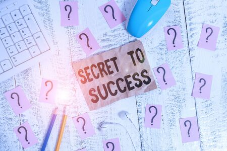 Text sign showing Secret To Success. Business photo showcasing Unexplained attainment of fame wealth or social status Writing tools, computer stuff and scribbled paper on top of wooden table