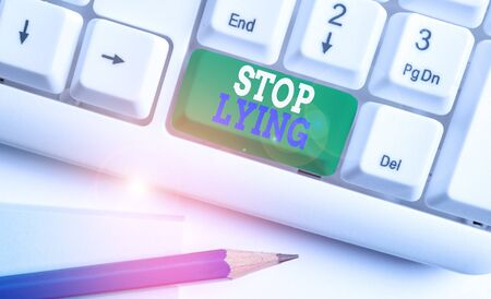 Text sign showing Stop Lying. Business photo text put an end on chronic behavior of compulsive or habitual lying White pc keyboard with empty note paper above white background key copy space