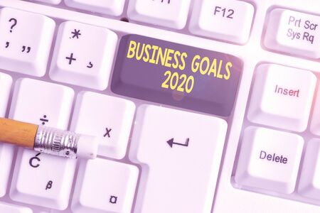 Word writing text Business Goals 2020. Business photo showcasing Advanced Capabilities Timely Expectations Goals White pc keyboard with empty note paper above white background key copy space