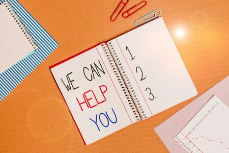 Conceptual hand writing showing We Can Help You. Concept meaning Support Assistance Offering Customer Service Attention Striped paperboard cardboard office study supplies chart 写真素材