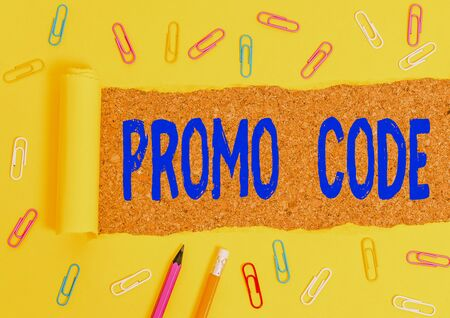 Conceptual hand writing showing Promo Code. Concept meaning digital numbers that give you good discount on certain product Stationary and torn cardboard on a wooden classic table backdrop
