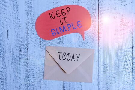 Handwriting text writing Keep It Simple. Conceptual photo Easy to toss around Understandable Generic terminology Front view closed envelop speech bubble lying wooden vintage background