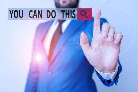 Text sign showing You Can Do This. Business photo text Eagerness and willingness to overcome challenges in life Businessman with pointing finger in front of him 写真素材