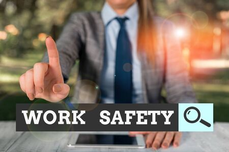 Text sign showing Work Safety. Business photo text policies and procedures in place to ensure safety in workplace Female business person sitting by table holding mobile phone Standard-Bild - 134494059