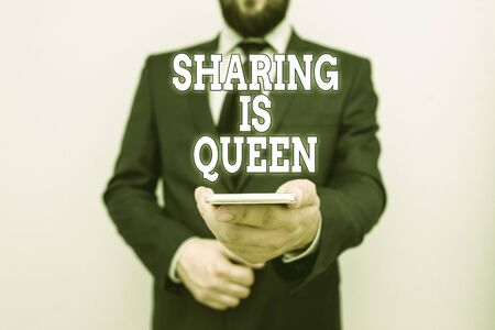 Text sign showing Sharing Is Queen. Business photo showcasing giving others information or belongs is great quality Male human wear formal work suit hold smart hi tech smartphone use one hand