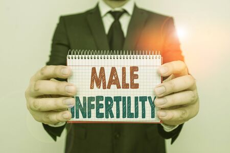 Writing note showing Male Infertility. Business concept for the inability to cause pregnancy in a fertile Male human wear formal work suit with office look hold book