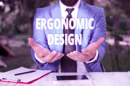 Text sign showing Ergonomic Design. Business photo showcasing fitting or designing a workplace to the user s is needs Man with opened hands in fron of the table. Mobile phone and notes on the table