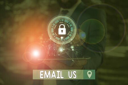 Writing note showing Email Us. Business concept for Sending a commercial message to a group of showing using mail Stock Photo