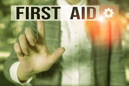 Text sign showing First Aid. Business photo showcasing Practise of healing small cuts that no need for medical training Business woman in the nature pointing with the finger into empty space