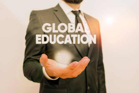 Conceptual hand writing showing Global Education. Concept meaning ideas taught to enhance one s is perception of the world Male human with beard wear formal working suit clothes hand