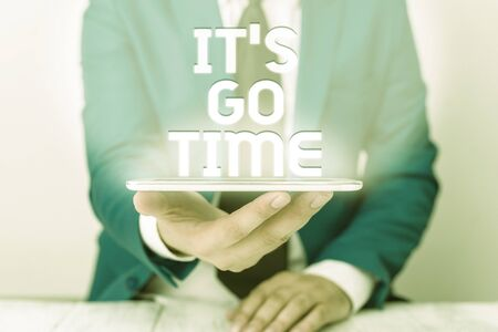 Text sign showing It S Go Time. Business photo text A period to undertake the assigned tasks Bring it ON Businessman in blue suite with a tie holds lap top in hands Imagens