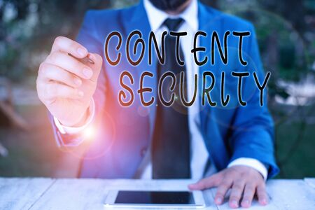 Conceptual hand writing showing Content Security. Concept meaning the protection against deliberate threats to content Businessman holds pen and points into copy space