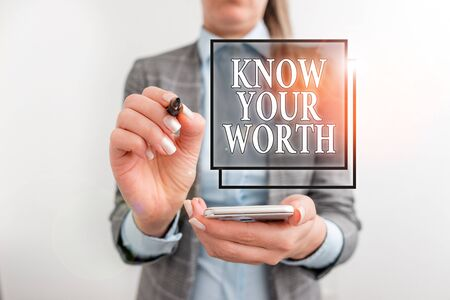 Handwriting text writing Know Your Worth. Conceptual photo Have knowledge of selfvalue Worthiness Deserved income Business concept with mobile phone and business woman