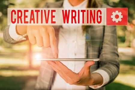 Handwriting text writing Creative Writing. Conceptual photo fiction or poetry which displays imagination or invention Outdoor scene with business woman holds lap top with touch screen Stok Fotoğraf